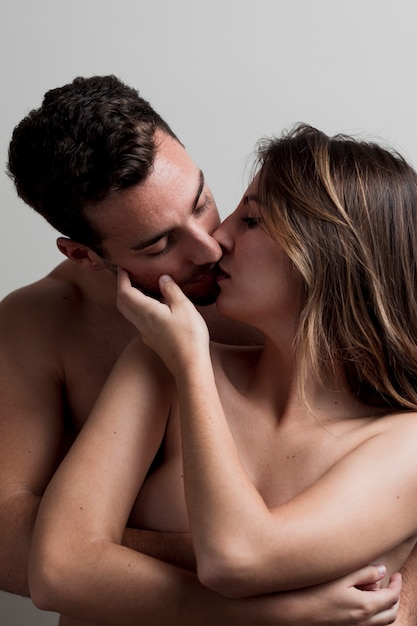Nude couples kissing each other