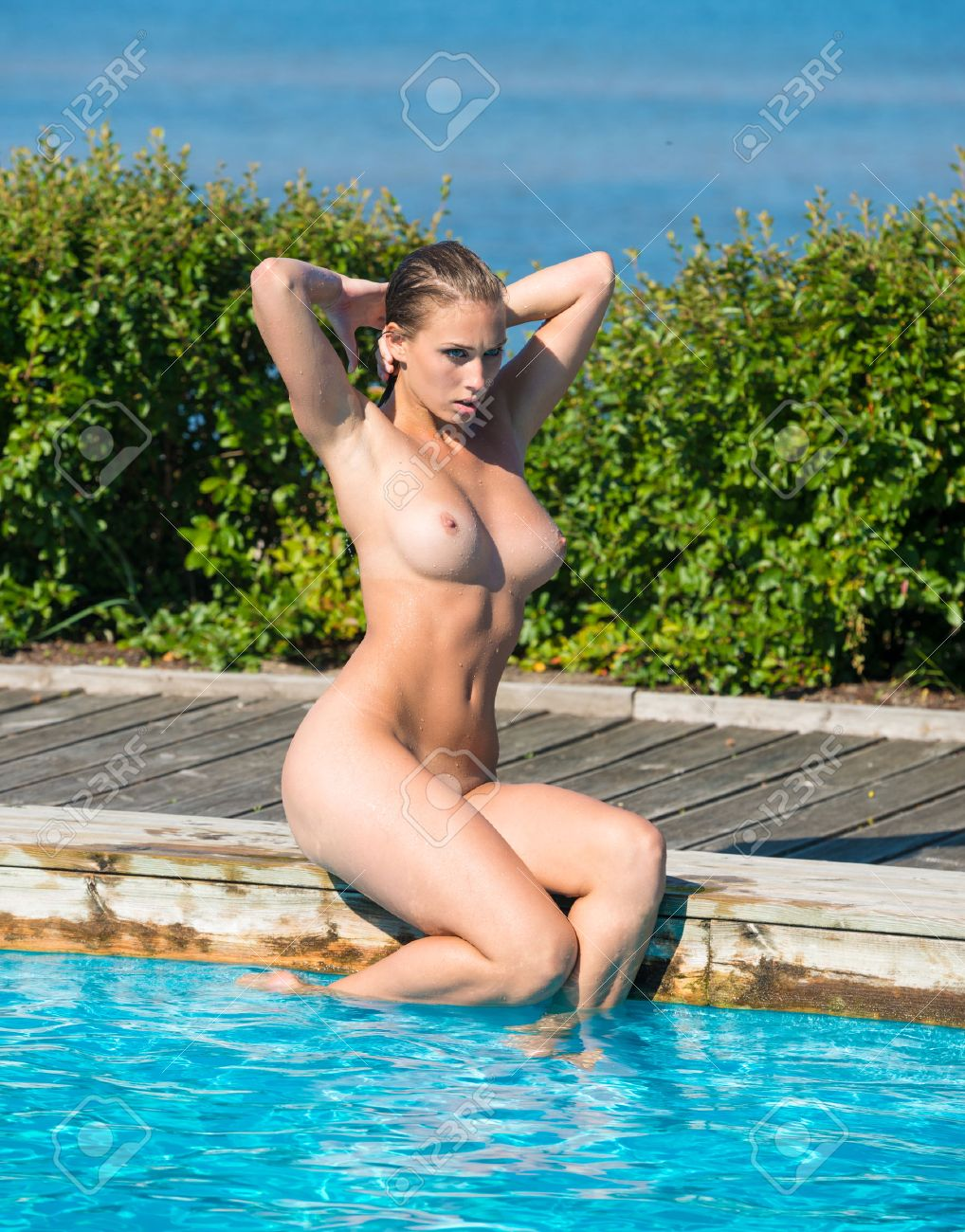 Sexy nude wet women at pool